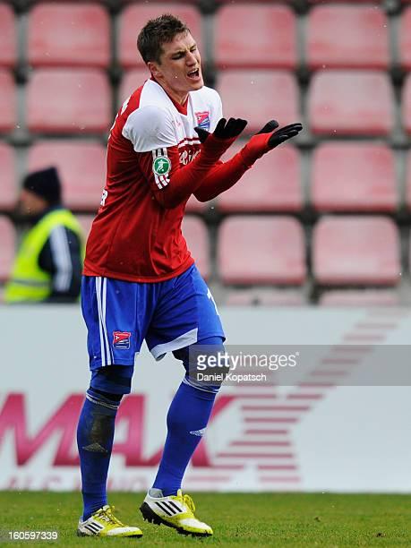Tobias Schweinsteiger of Unterhaching reacts during the third Bundesliga match between SpVgg Unterhaching and Hallescher FC on February 3 2013 in...