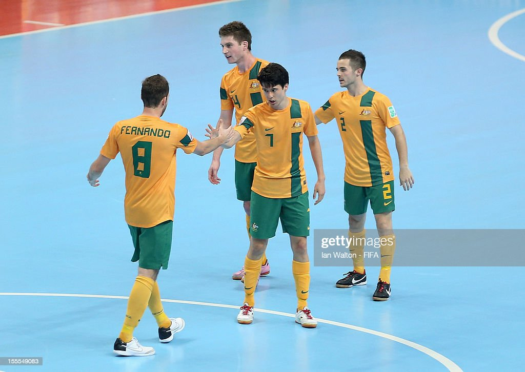 Tobias Seeto of Australia celebrates with team-mates after scoring a goal during the FIFA Futsal World Cup Thailand 2012, Group D match between Australia and Mexico at Nimibutr Stadium on November 5, 2012 in Bangkok, Thailand.