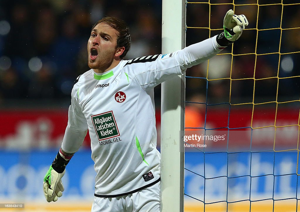 <a gi-track='captionPersonalityLinkClicked' href=/galleries/search?phrase=Tobias+Sippel&family=editorial&specificpeople=750795 ng-click='$event.stopPropagation()'>Tobias Sippel</a>, goalkeeper of Kaiserslautern gives instructions during the second Bundesliga match between Eintracht Braunschweig and 1. FC Kaiserslautern at Eintracht Stadium on March 11, 2013 in Braunschweig, Germany.