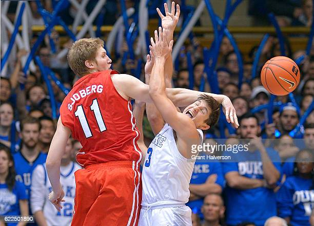 Tobias Sjoberg of the Marist Red Foxes battles Grayson Allen of the Duke Blue Devils for a rebound during the game at Cameron Indoor Stadium on...