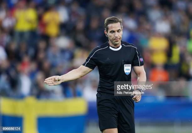 Tobias Stieler referee points to the penalty spot during the UEFA European Under21 Championship match between Sweden and England at Arena Kielce on...