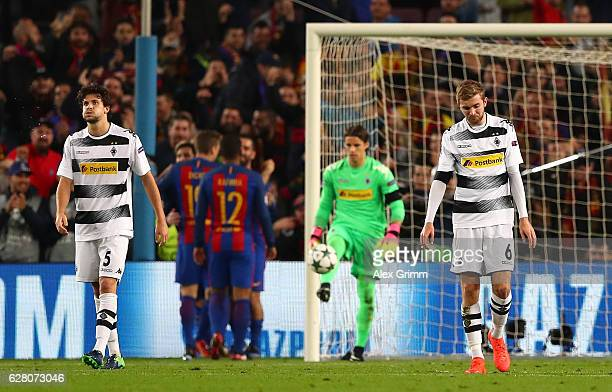 Tobias Strobl of Borussia Moenchengladbach and Christoph Kramer of Borussia Moenchengladbach are dejected after Barcelona score during the UEFA...
