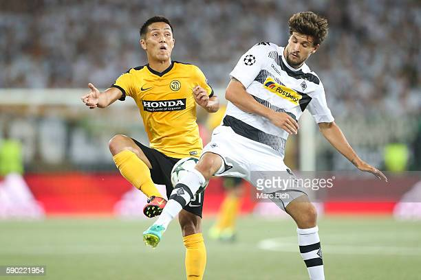 Tobias Strobl of Borussia Moenchengladbach challenges Yuya Kubo of Young Boys Bern during the Champions League Playoff match between Young Boys Bern...