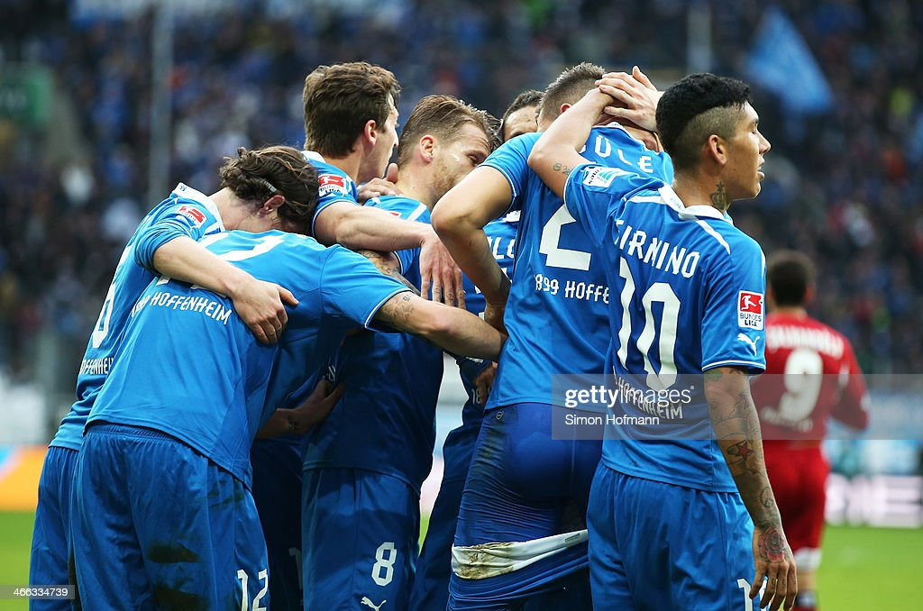 Tobias Strobl of Hoffenheim pulls down the shorts of Niklas Suele of Hoffenheim as they celebrate their team's second goal during the Bundesliga...