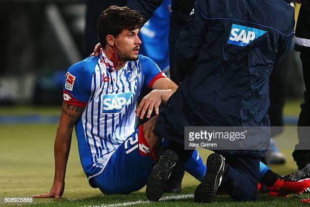 Tobias Strobl of Hoffenheim receives treatment during the Bundesliga match between 1899 Hoffenheim and SV Darmstadt 98 at Wirsol RheinNeckarArena on...