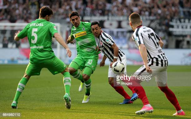 Tobias Strobl of Mönchengladbach and Lars Stindl of Mönchengladbach and Marco Fabian of Frankfurt and Ante Rebic of Frankfurt battle for the ball...