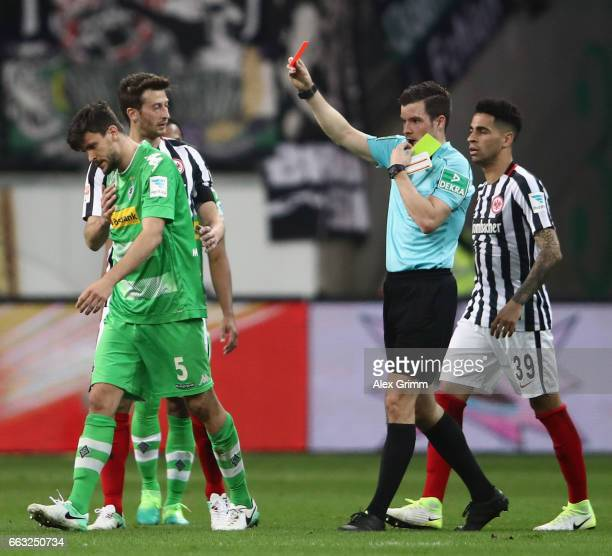 Tobias Strobl of Moenchengladbach is sent off by referee Harm Osmers during the Bundesliga match between Eintracht Frankfurt and Borussia...