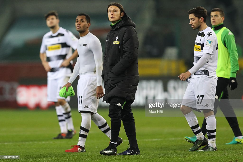 Tobias Strobl (L-R), Raffael; Djibril Sow, Julian Korb and Laszlo Benes of Moenchengladbach react after the Bundesliga match between Borussia Moenchengladbach and VfL Wolfsburg at Borussia-Park on December 20, 2016 in Moenchengladbach, Germany.