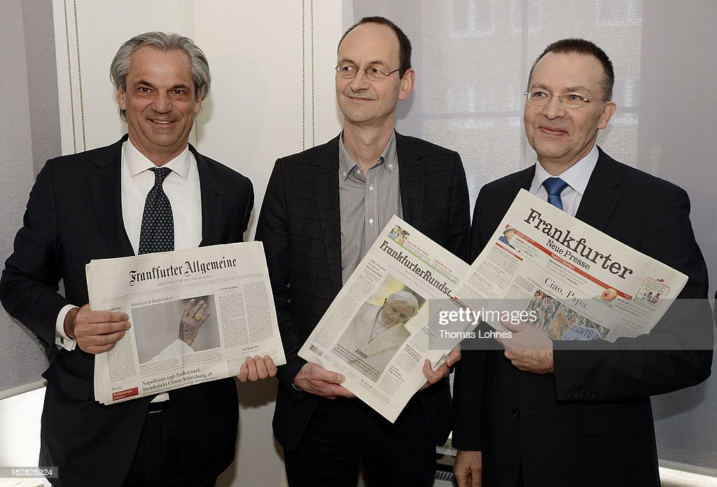 Tobias Trevisan, speaker of the management board of the Frankfurter Allgemeine Zeitung, Arnd Festerling chief editor of the Frankfurter Rundschau and Hans Homrighausen, manager of the Frankfurter Societaets GmbH (l-r) pose with the Frankfurter Allgemeine Zeitung, Frankfurter Rundschau and the Frankfurter Neue Presse newspapers before the press conference on February 28, 2013 in Frankfurt am Main, Germany. The Frankfurter Rundschau has been bought by the Frankfurter Allgemeine Zeitung after the Federal Cartel Office in Bonn allowed the acquisition on Wednesday afternoon.