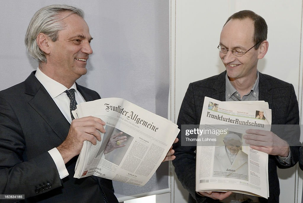 Tobias Trevisan (l), speaker of the management board of the Frankfurter Allgemeine Zeitung and Arnd Festerling (r) chief editor of the Frankfurter Rundschau pauses with the newspapers Frankfurter Allgemeine Zeitung, Frankfurter Rundschau und Frankfurter Neue Presse before the press conference on February 28, 2013 in Frankfurt am Main, Germany. The Frankfurter Rundschau is bought by the Frankfurter Allgemeine Zeitung. The Cartel Office in Bonn has allowed the acquisition on Wednesday afternoon.