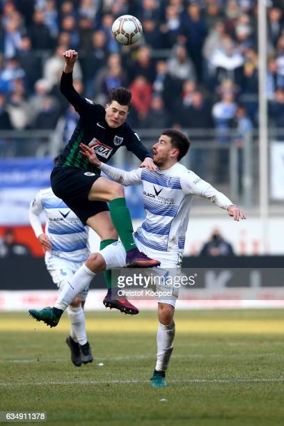 Tobias Warschewski of Muenster and Dustin Bomheuer of Duisburg go up for a header during the Third League match between MSV Duisburg and Preussen...