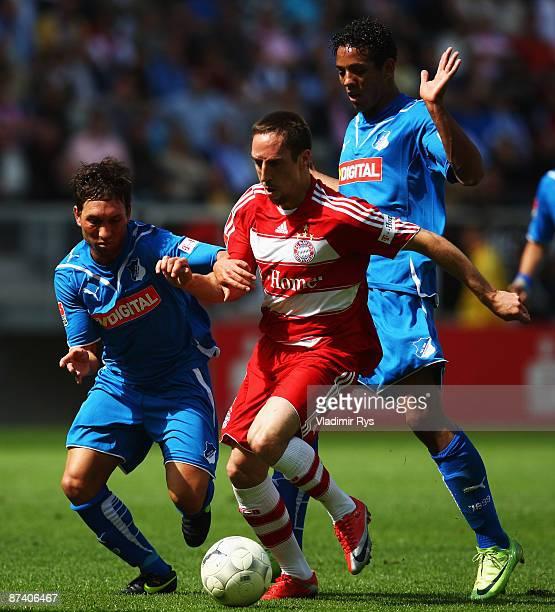 Tobias Weis and Wellington of Hoffenheim challenge Franck Ribery of Bayern during the Bundesliga match between 1899 Hoffenheim and FC Bayern Muenchen...