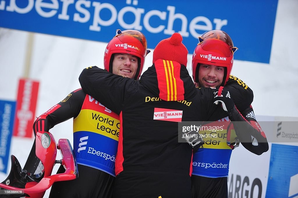 Tobias Wendl (R) and Tobias Arlt of Germany celebrate after their run at the Luge World Cup Doubles competition on December 15 , 2012 in Sigulda, Latvia, some 50 km northeast of Riga. The pair finished first ahead of Peter Penz and Georg Fischer of Austria (2nd) and Christian Oberstolz and Patrick Gruber (3rd) of Italy. AFP PHOTO/ILMARS ZNOTINS