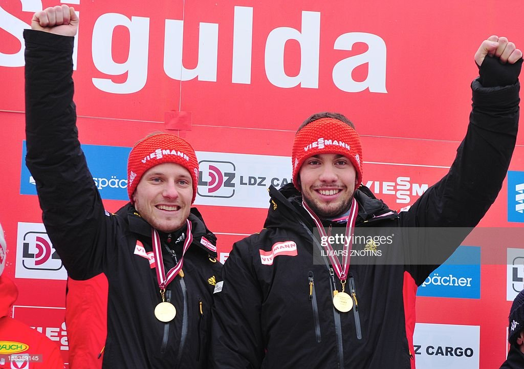 Tobias Wendl (R) and Tobias Arlt of Germany celebrate after winning the Luge World Cup Doubles event on December 15 , 2012 in Sigulda, Latvia, some 50 km northeast of Riga. The pair placed first ahead of Peter Penz and Georg Fischer (2nd) of Austria and Christian Oberstolz and Patrick Gruber (3rd) of Italy.