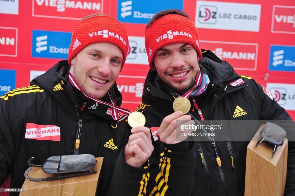 Tobias Wendl (R) and Tobias Arlt of Germany celebrate after winning the Luge World Cup Doubles event on December 15 , 2012 in Sigulda, Latvia, some 50 km northeast of Riga. The pair placed first ahead Peter Penz and Georg Fischer (2nd) of Austria and Christian Oberstolz and Patrick Gruber (3rd) of Italy.