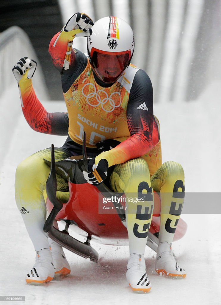 <a gi-track='captionPersonalityLinkClicked' href=/galleries/search?phrase=Tobias+Wendl&family=editorial&specificpeople=4784289 ng-click='$event.stopPropagation()'>Tobias Wendl</a> and <a gi-track='captionPersonalityLinkClicked' href=/galleries/search?phrase=Tobias+Arlt&family=editorial&specificpeople=4784288 ng-click='$event.stopPropagation()'>Tobias Arlt</a> of Germany finish a run during the Luge Relay on Day 6 of the Sochi 2014 Winter Olympics at Sliding Center Sanki on February 13, 2014 in Sochi, Russia.