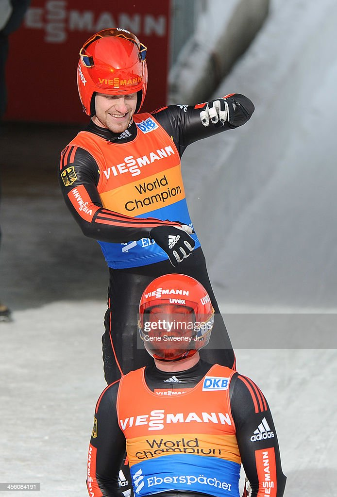 Tobias Wendl (seated) and <a gi-track='captionPersonalityLinkClicked' href=/galleries/search?phrase=Tobias+Arlt&family=editorial&specificpeople=4784288 ng-click='$event.stopPropagation()'>Tobias Arlt</a> of Germany react to finishing first in the Doubles competition during the Viessmann Luge World Cup at Utah Olympic Park December 13, 2013 in Park City, Utah.