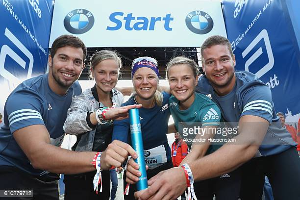 Tobias Wendl Anna Hahner Miriam Goessner Lisa Hahner and Johannes Lochner all members of the BMW Wintersport relay team smiles prior to the start for...