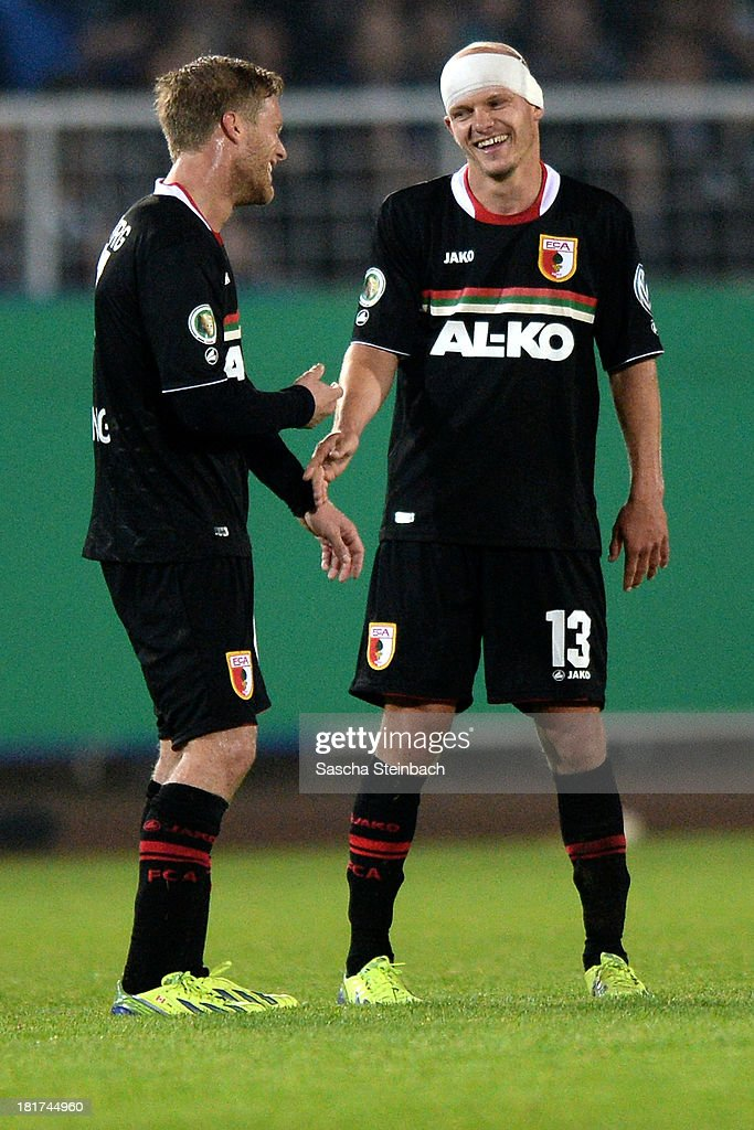 Tobias Werner of Augsburg celebrates after scoring his team's 3rd goal with Marcel De Jong of Augsburg during DFB Cup second round match between Preussen Muenster and FC Augsburg at Preussenstadion on September 24, 2013 in Muenster, Germany.