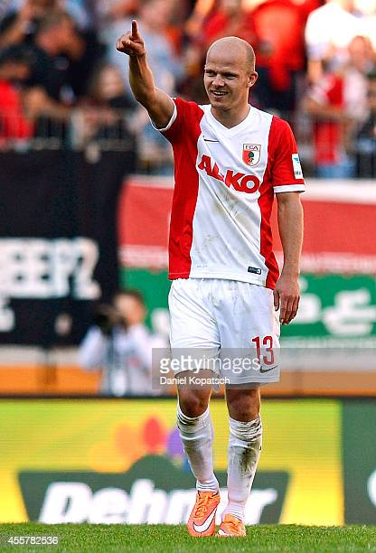 Tobias Werner of Augsburg celebrates his team's third goal during the Bundesliga match between FC Augsburg and SV Werder Bremen at SGL Arena on...