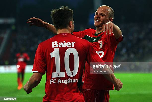 Tobias Werner of Augsburg celebrates with team mate Daniel Baier after scoring his teams first goal during the Second Bundesliga match between...