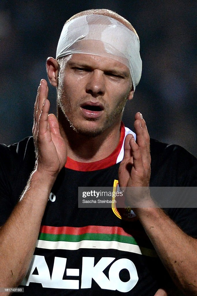 Tobias Werner of Augsburg wears a head bandage after picking up an injury during DFB Cup second round match between Preussen Muenster and FC Augsburg at Preussenstadion on September 24, 2013 in Muenster, Germany.