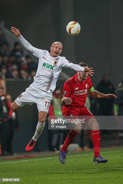 Tobias Werner of FC Augsburg and Jordan Henderson of FC Liverpool battle for the ball during the UEFA Europa League match between FC Augsburg and...