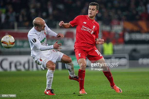 Tobias Werner of FC Augsburg and Philippe Coutinho of FC Liverpool battle for the ball during the UEFA Europa League match between FC Augsburg and...