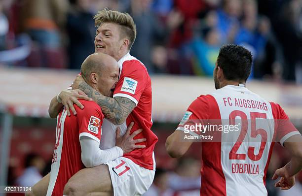 Tobias Werner of FC Augsburg celebrate with team mate Alexander Esswein their team's opening goal during the Bundesliga match between FC Augsburg and...