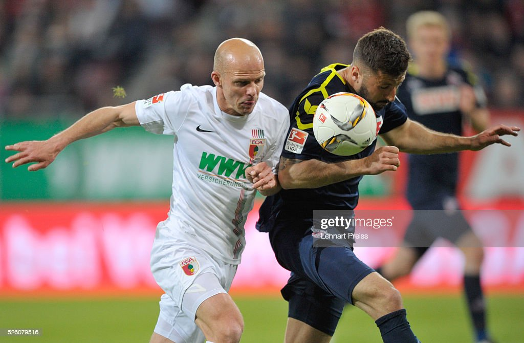 Tobias Werner (L) of FC Augsburg challenges <a gi-track='captionPersonalityLinkClicked' href=/galleries/search?phrase=Dominic+Maroh&family=editorial&specificpeople=5633010 ng-click='$event.stopPropagation()'>Dominic Maroh</a> of 1. FC Koeln during the Bundesliga match between FC Augsburg and 1. FC Koeln at WWK Arena on April 29, 2016 in Augsburg, Germany.