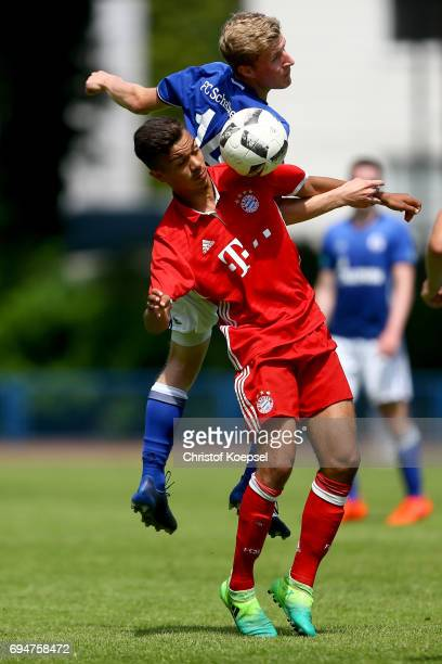 Tobias Wieschuss of Schalke and Oliver Batista Meier of Bayern go up for a header during the B Juniors German Championship Semi Final match between...