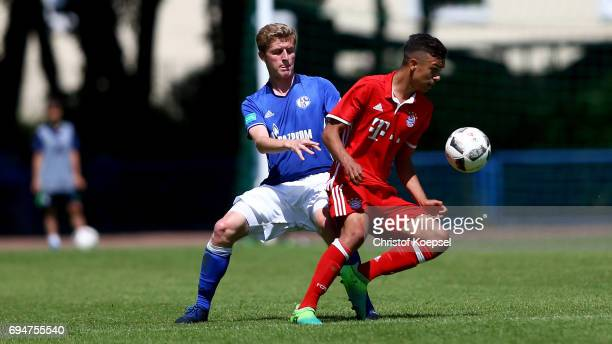 Tobias Wieschuss of Schalke challenges Oliver Batista Meier of Bayern during the B Juniors German Championship Semi Final match between FC Schalke...