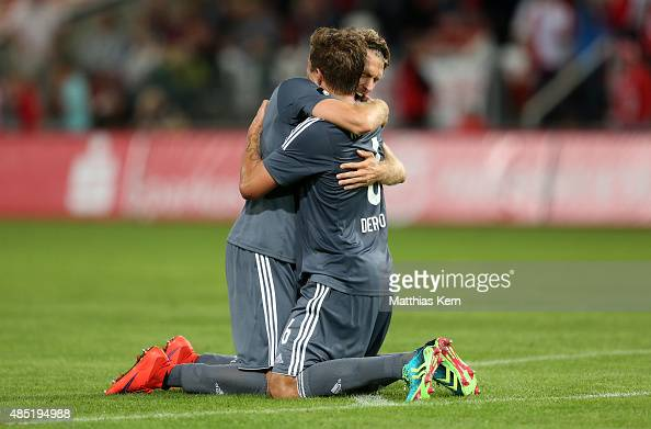 Tobias Willers of Osnabrueck and team mate Alexander Dercho show their delight after winning the third league match between FC Energie Cottbus and...