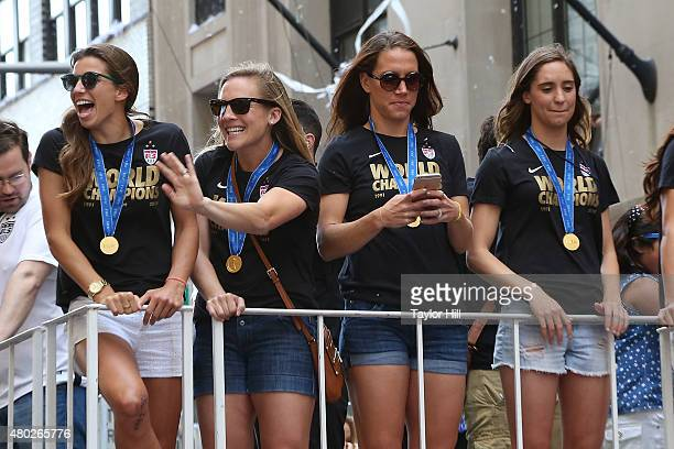 Tobin Heath Amy Rodriguez Lauren Holiday and Morgan O'Brien ride in a tickertape parade commemorating the World Cup victory of the US Women's...