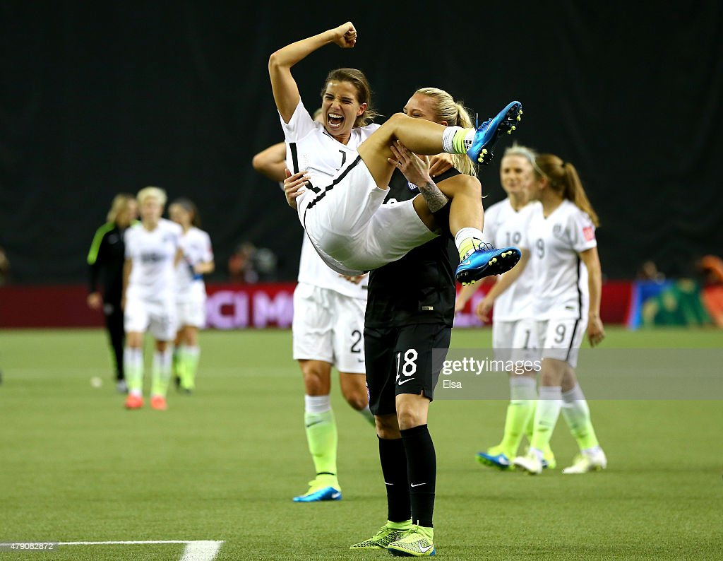 Tobin Heath #17 celebrates with Ashlyn Harris #18 of the United States after the 2-0 victory against Germany in the FIFA Women's World Cup 2015 Semi-Final Match at Olympic Stadium on June 30, 2015 in Montreal, Canada.