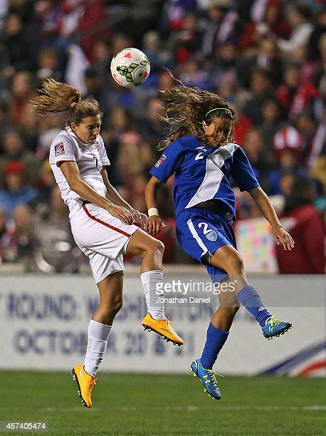 Tobin Heath of the United States and Daniela Andrade of Guatemala go up for a header during the 2014 CONCACAF Women's Championship at Toyota Park on...