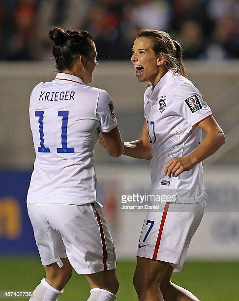 Tobin Heath of the United States celebrates her first half goal with Ali Krieger against Guatemala during the 2014 CONCACAF Women's Championship at...