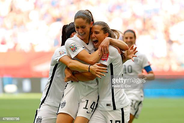 Tobin Heath of the United States celebrates with Morgan Brian after Heath scores in the second half against Japan in the FIFA Women's World Cup...