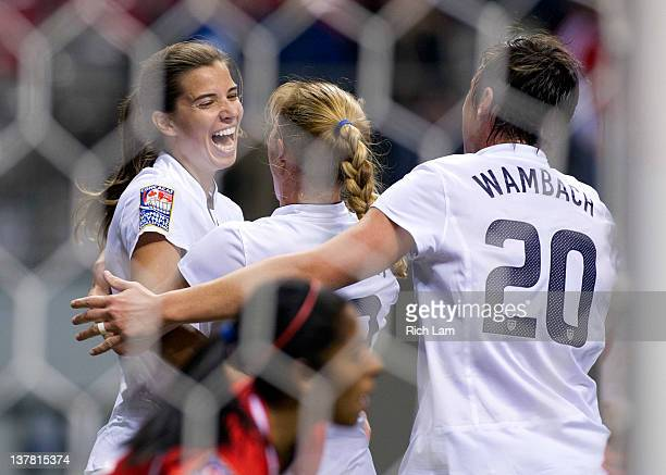 Tobin Heath of the United States celebrates with Rachel Buehler and Abby Wambach after scoring a goal against Costa Rica during first half of...
