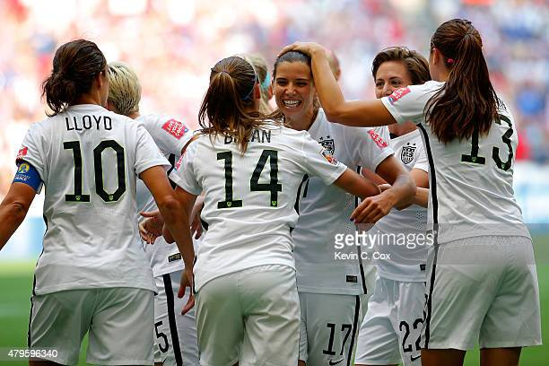 Tobin Heath of the United States celebrates with teammates after Heath scores in the second half against Japan in the FIFA Women's World Cup Canada...