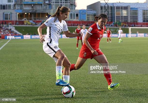 Tobin Heath of the United States controls the ball against Wang Lisi of China in the second half in the FIFA Women's World Cup 2015 Quarter Final...