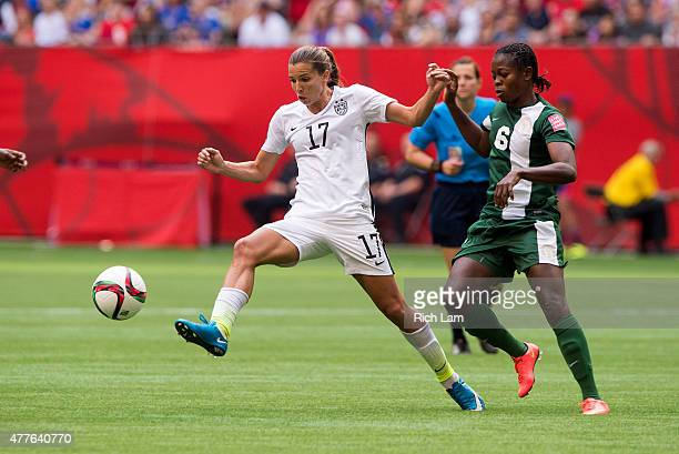 Tobin Heath of the United States tries to control the ball while fighting off Josephine Chukwunonye of Nigeria during the FIFA Women's World Cup...