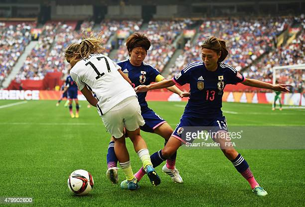 Tobin Heath of USA is challenged by Rumi Utsugi and Mizuho Sakaguchi of Japan during the FIFA Women's World Cup Final between USA and Japan at BC...