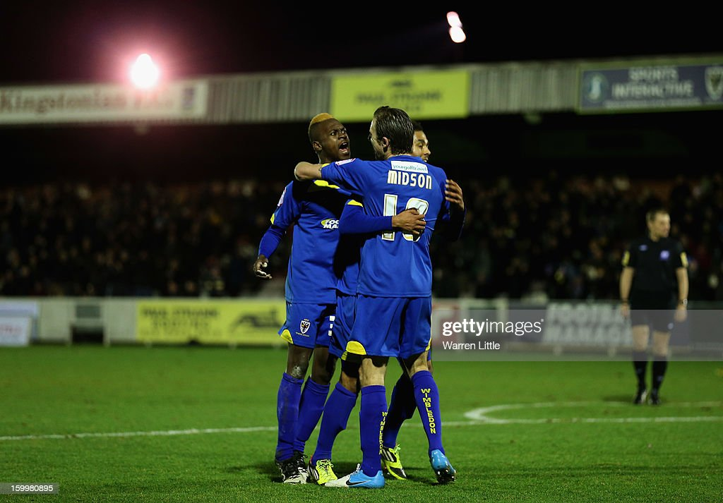 Toby Ajala of AFC Wimbledon congratulates team mate Jack Midson of AFC Wimbledon after scoring the opening goal during the npower League Two match between AFC Wimbledon and Port Vale at The Cherry Red Records Stadium on January 24, 2013 in Kingston upon Thames, England.