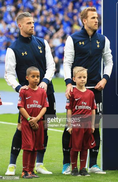 Toby Alderweireld and Harry Kane of Tottenham Hotspur line up with mascots prior to The Emirates FA Cup SemiFinal between Chelsea and Tottenham...