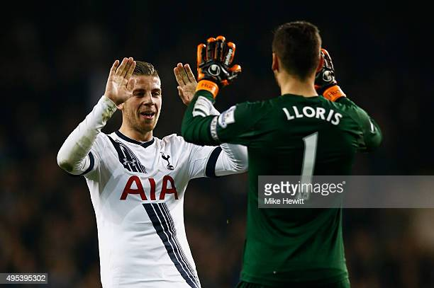 Toby Alderweireld and Hugo Lloris of Tottenham Hotspur celebrate as Harry Kane scores their third goal during the Barclays Premier League match...