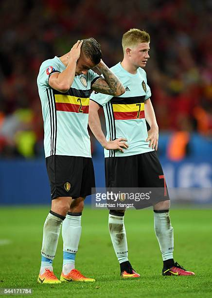 Toby Alderweireld and Kevin De Bruyne of Belgium show their dejection after their team's 13 defeat in the UEFA EURO 2016 quarter final match between...