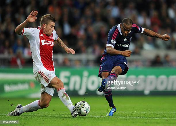 Toby Alderweireld of Ajax blocks a shot from Jimmy Briand of Olympique Lyonnais during the UEFA Champions League group D match between AFC Ajax and...
