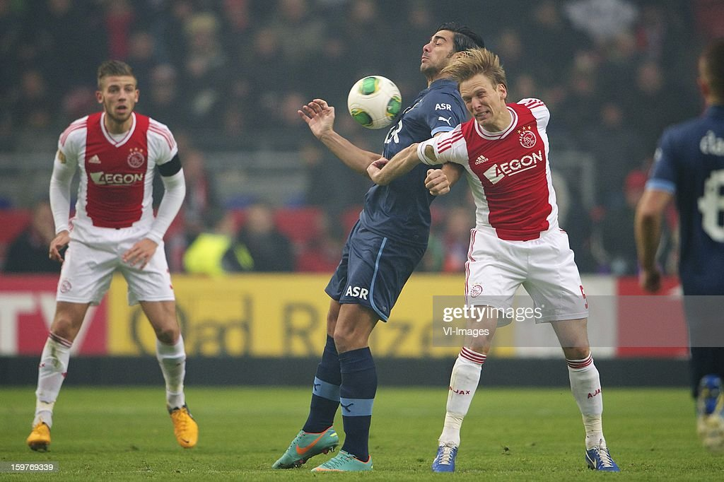 Toby Alderweireld of Ajax, Graziano Pelle of Feyenoord, Christian Poulsen of Ajax during the Dutch Eredivise match between Ajax Amsterdam and Feyenoord at the Amsterdam Arena on January 20, 2013 in Amsterdam, The Netherlands.