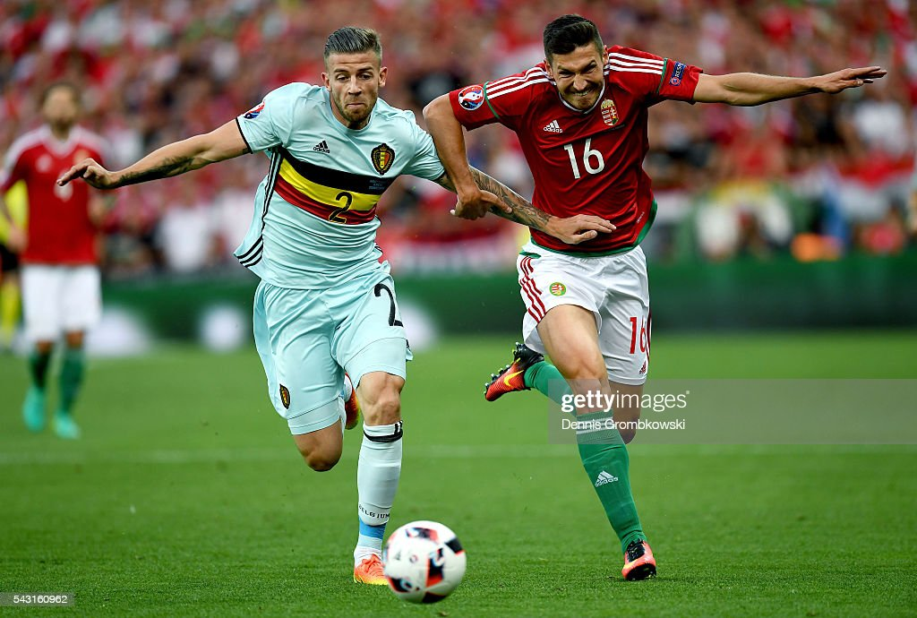 Toby Alderweireld of Belgium and Adam Pinter of Hungary compete for the ball during the UEFA EURO 2016 round of 16 match bewtween Hungary and Belgium at Stadium Municipal on June 26, 2016 in Toulouse, France.